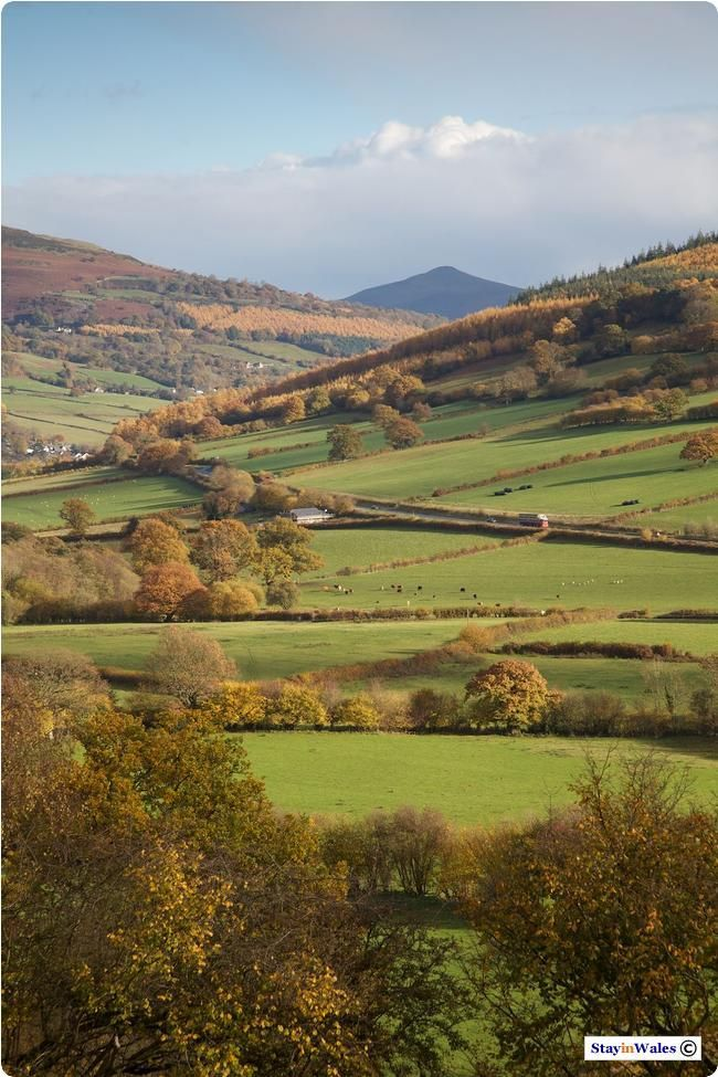 Usk Valley and Sugar Loaf, Wales (UK). - Looking east along the Usk Valley from the village of Bwlch. To the right the A40 runs around Myarth, a small wooded hill, before meeting the river again. On the horizon is the Sugar Loaf, a prominent landmark in these parts, which is above the town of Abergavenny.