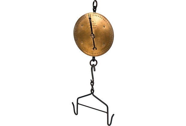 """This large hanging brass scale has a cast iron meat hook attached. Produced by Salter's Scale in the United Kingdom, this company has been producing scales since 1760. This brass and cast iron spring balance scale is a work of art."""