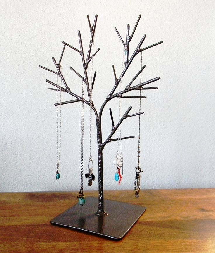 This handmade tree display is a one of a kind. Its a stylish way to organize your jewelry at home or display it at a craft fair or boutique. Its also a great home decorating piece or photography prop.    I make each of my welded steel jewelry displays through a labor intensive (and noisy) process of cutting the metal, grinding, welding, more grinding, then a few coats of paint. They are made from solid steel to be sturdy, unique, and last a lifetime. This tree has a metallic hammered brown…