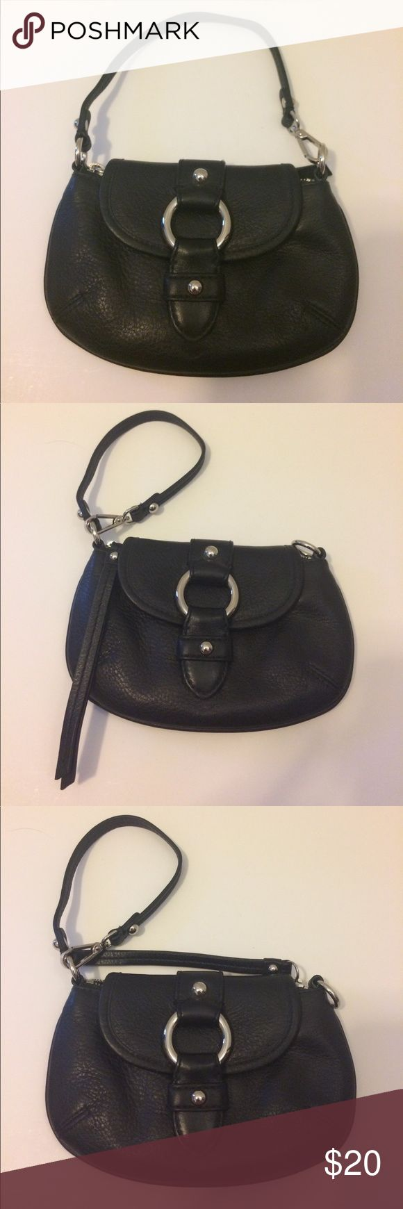 "Banana Republic Black Leather Wristlet EUC EUC black leather convertible wristlet. Magnetic flap closure with zipper closure. Has slots to hold your ID and/or credit cards. Approximately 8"" x 5"". Banana Republic Bags Clutches & Wristlets"