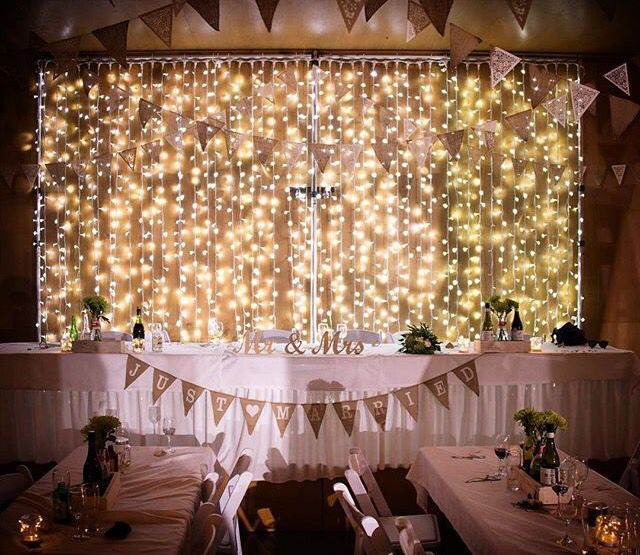 Epic! LED Fairy Light drapes behind the #bridal table! #TSHweddings #lighting #wedding
