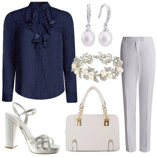 Un+paio+di+pantaloni+bianchi,+dal+taglio+morbido+vengono+proposti+con+una+camicia+blu+a+pois+e+volants+sul+davanti.+Le+scarpe+sono+dei+sandali+con+cinturino+alla+caviglia+con+tacco+alto+la+borsa+a+mano+ha+degli+inserti+gioiello.+Un+paio+di+orecchini+e+un+bracciale+con+le+perle+completano+il+tutto.