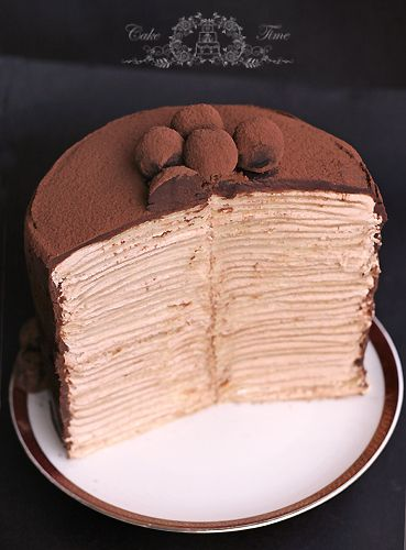Crepes Cake with swiss meringue buttercream and chocolate truffles... #chocolate OMG I'm a fan of crepes cakes...my fav is grandmarnier crepe cake but will have to try this one...mmm