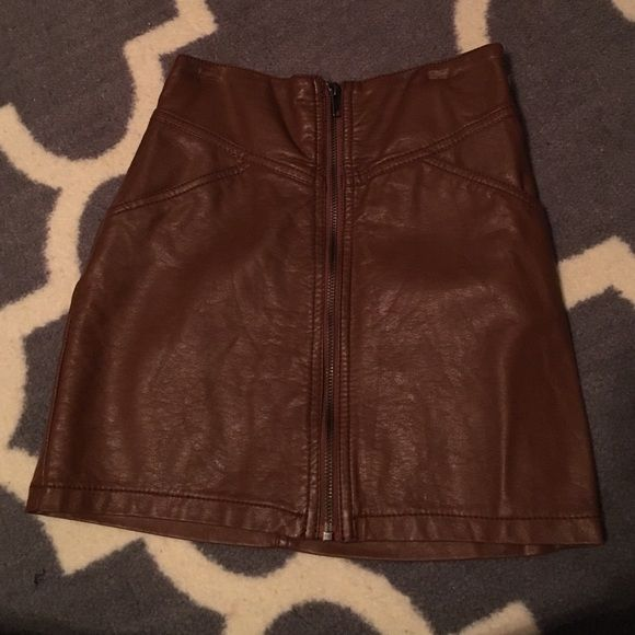 high waisted tan leather skirt Zips in the front with an inside button also. amazing condition and priced because of my love for it. has small indents from my hanger but not noticeable when wear and I'm sure they fade once take off hanger. faux leather H&M Skirts Mini