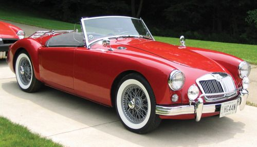 MG A Roadster (1955)  British heart in italian red. You can't find a single fault with this MGA.  It is just not possible. Not because it doesn't have them, but simply because you wouldn't even dare to begin searching for them. You'd have to be a complete heartless fool.
