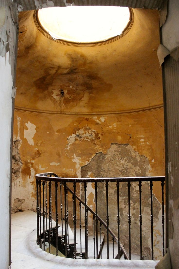 Mustard wall color in stairway of French Chateau de Gudanes...fascinating post