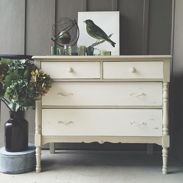 This antique dresser is hand painted in Chalk Paint® by Annie Sloan in Country Grey, a cool soft neutral with a green tint, and Old White. Lovely project by stockist Edwin Loy Home in Westerville, OH. #edwinloyhome #edwinloyhomedelaware #elhome #elh #chalkpaint #anniesloan
