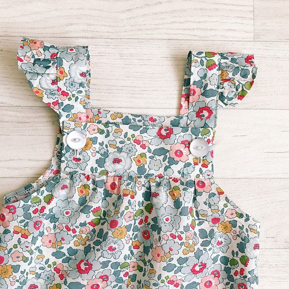 Versatile dungarees, perfect for playtime. Handmade in the most exquisite Liberty of London fabric. True luxury, Liberty of London Tana Lawn feels like silk to touch and is extremely lightweight, perfect for delicate skin. Dungarees are shown here in Betsy. For further assistance