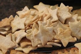 Star shaped dippers! These were so simple to make: Use a cookie cutter to cut store-bought tortillas. Toss them on a cookie sheet with a little olive oil. Bake at 350 for 20 min.