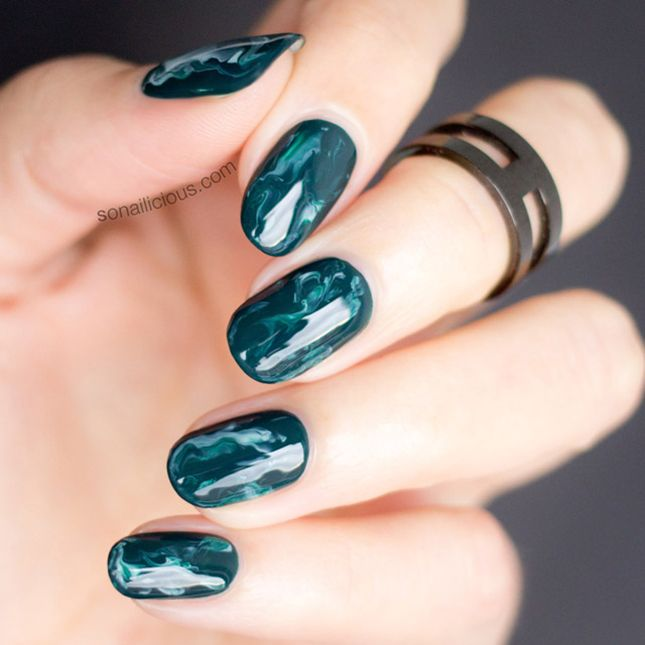 9 Marble Nails That Will Instantly Upgrade Your Mani via Brit + Co