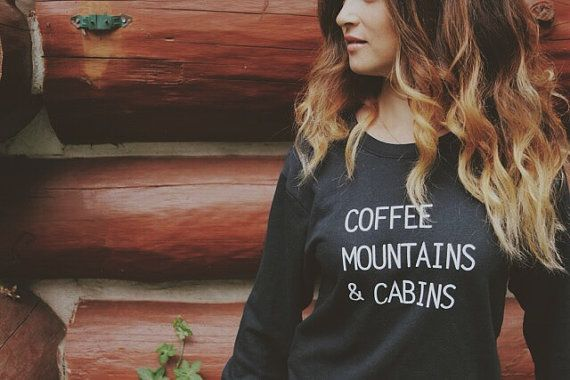 Throw on this cozy black sweatshirt and take in those mountain views with a hot cup of coffee in a cozy little cabin... either for real or