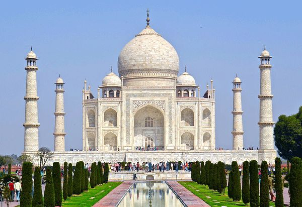 An ivory-white marble mausoleum on the south bank of the Yamuna river