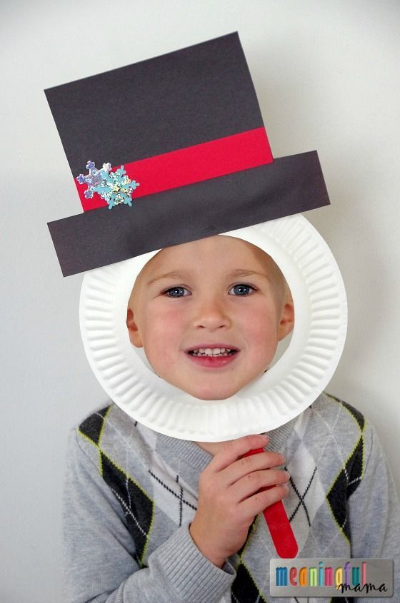 Snowman paper plate masks for a simple and inexpensive craft idea that can easily be done at a classroom party.