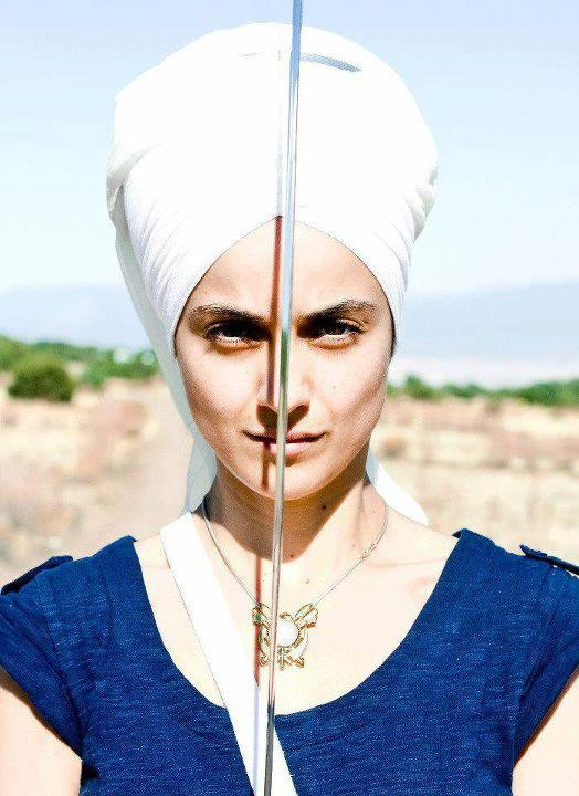Beautiful Sikh Lady...Keeping Mind Focused on the Creator's Universe.  Sikhism teaches gender equality which is why both male and females dress similar.