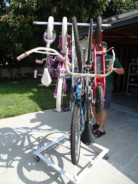 Mobile bike rack -- easily move all of the bikes around in the garage or roll 'em outside.  great idea!