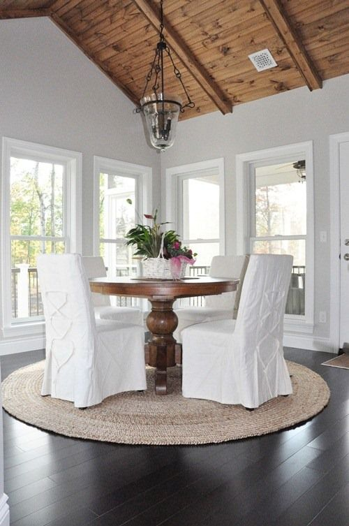 I would not do the white chair covers.. But wood and white fabric chairs would work just fine ;) love the look and open feel