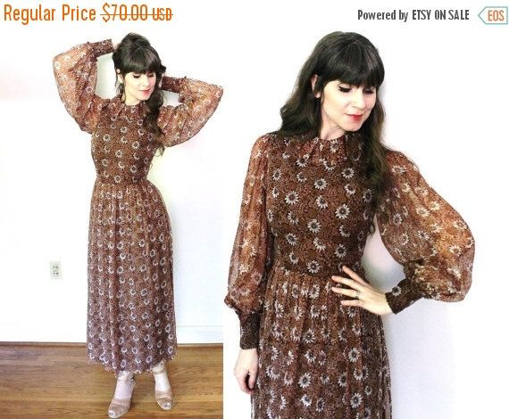 BLACK FRIDAY SALE 1970s Dress / 70s Brown Floral Sheer Billowy Sleeves Dress by Coldfish on Etsy https://www.etsy.com/listing/252383706/black-friday-sale-1970s-dress-70s-brown