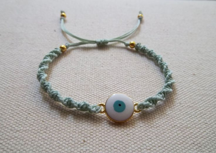 Evil eye twisted makrame jewelry in light turquoise colour   macrame bracelet gift for her boho chic handmade gold green  egst by KnotknotBijoux on Etsy