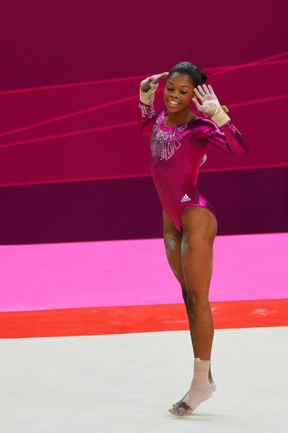 US gymnast Gabby Douglas performs on the floor during the artistic gymnastics women's individual all-around final at the 02 North Greenwich Arena in London on August 2, 2012 during the London 2012 Olympic Games. Douglas won the event.
