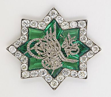 One of Queen Victoria's Turkish brooches - In June 1838, soon after her coronation, Queen Victoria received a star-shaped brooch of emeralds and diamonds from Sultan Mahmud II. In the centre of the brooch is the Sultan's tughra in brilliant cut diamonds. The tughra is the Sultan's personal calligraphic monogram which was affixed to all official documents, correspondence, coins and seals. The tughra of Mahmud II reads: 'Mahmud Khan son of Abdülhamid is forever victorious'.
