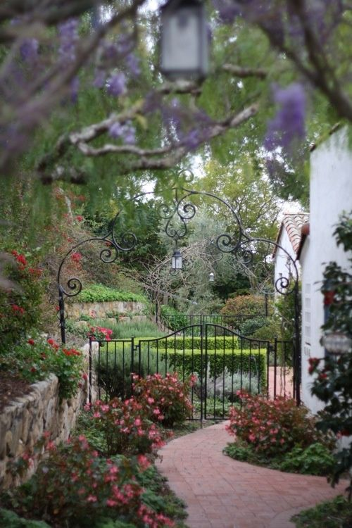 Beautiful depth. love the curved brick path & wrought iron gate