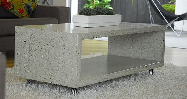 A polished concrete coffee table with many aggregate, pebble and sea shell choices