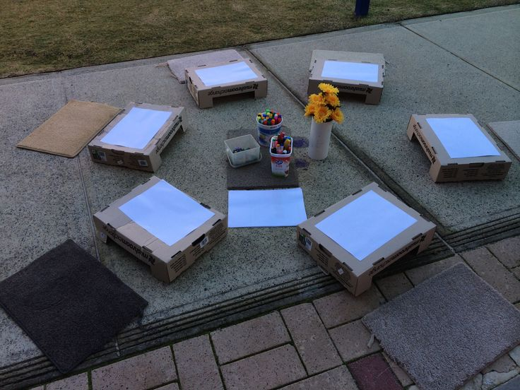 From trash to treasure - using mushroom boxes we collected from Woolworth as a desk for our outdoor drawing corner