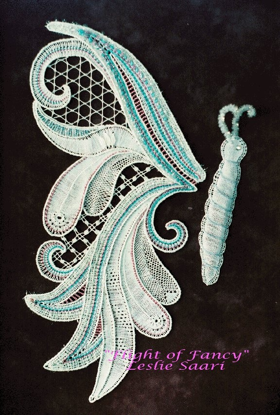 """""""Flight of Fancy"""" - Original design by Leslie Saari 1995.  This piece was originally designed, upon request for the Detroit Zoo, who eventually declined the piece.  It was featured on the cover of The Great Lakes Lace Group 25th Anniversary Booklet.  It now resides in a private collection."""