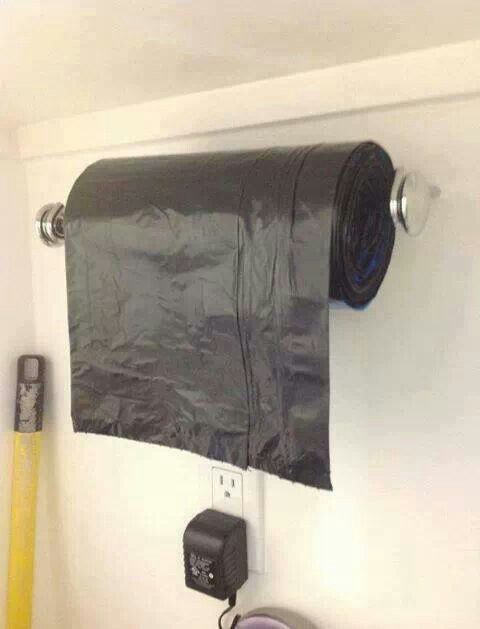 """""""Garbage bags on paper towel holder or rod"""" seems like a good idea if it doesn't accidently unroll!"""