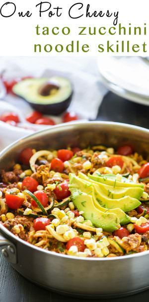 One Pot Cheesy Taco Zucchini Noodle Skillet is a healthy spin on Taco Tuesday! Zucchini noodles, enchilada spiced ground turkey, black beans, corn and creamy avocado help makeover this dish!