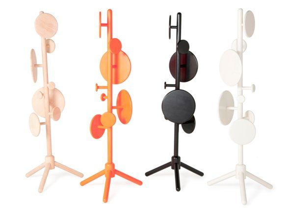 A totem  for hats,   coats and bags with  circular discs instead of traditional hooks. Peg   Coat Stand has 8 discs in 4  different sizes which are fitted to the   stand using wooden dowels. The product  is flat-packed allowing you to   arrange the discs in whatever configuration you  wish. MATERIALS:  Wood  MEASUREMENTS:  Height: 70.86 inch Diameter: 28.93 inch
