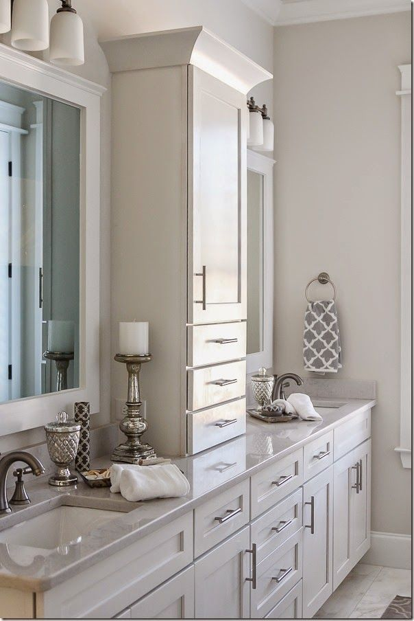 Example for Master Bath double vanity. Not style but shows upper cabinet  between sinks.
