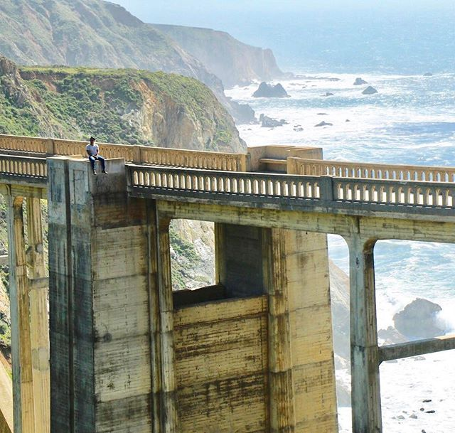 I had the best view of my life ⛰ can you see me?  #pictureoftheday #bigsur #bixbybridge #bixby #monterey #northerncalifornia #bayarea #vacation #trip #ocean #view #canonimages #canon #photooftheday #beatiful #wonderful #niceplace #paradaise #highway1 #inked #tattooed  PC  @brenes77 #bigsurlocals #montereybaylocals - posted by Maurizio Menjivar. https://www.instagram.com/srmaurizio - See more of Big Sur at http://bigsurlocals.com