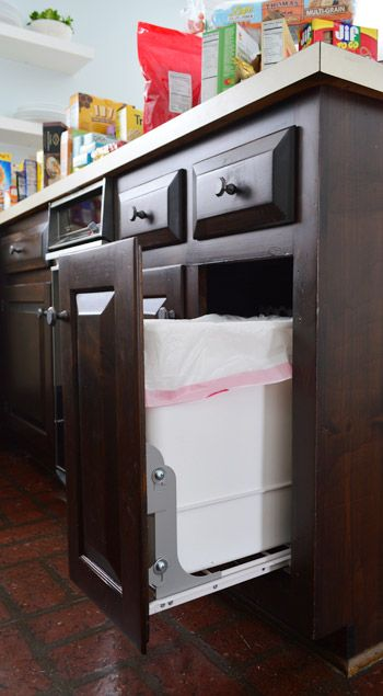 "Taking The Trash Out | Young House Love LOVE this idea of ""hiding"" and making practical function out of trash - AND/OR recyclable.  Would love to install in one of our cabinets..."