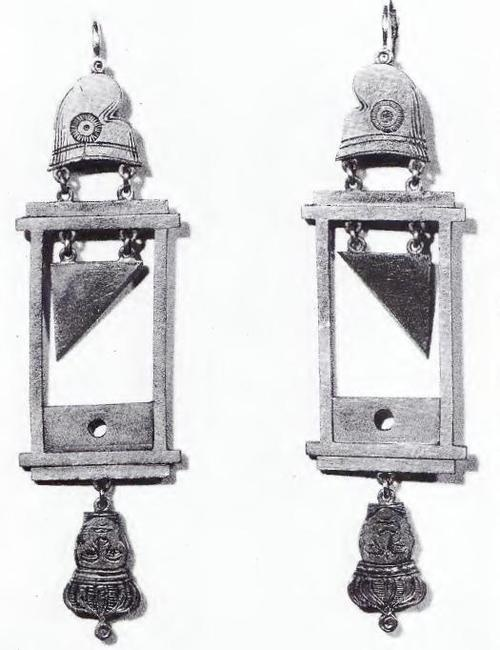 These are earrings showing Louis XVI's head getting chopped off.  In the years following the end of the Reign of Terror macabre fashion like this was popular, along with wearing shirts resembling the chemises obligatory for those being sent to the guillotine and haircuts in the same manner as those given to people right before they were beheaded.