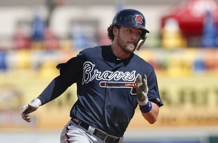 Feb 27, 2017; Lakeland, FL, USA; Atlanta Braves shortstop Dansby Swanson (7) rounds third base to score during the fourth inning of a spring training baseball game against the Detroit Tigers at Joker Marchant Stadium. Mandatory Credit: Reinhold Matay-USA TODAY Sports