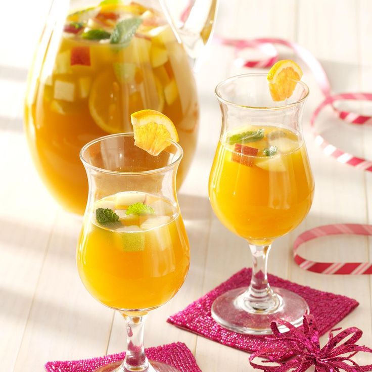 Spicy Apricot Sangria Recipe -This sweet-tart fruit punch is scented with cinnamon, allspice and cloves, which makes it a fantastic beverage for winter and fall. If you like use, 1 medium red-skinned apple and 1 medium green-skinned apple for even more color.—Tina Bellows, Racine, Wisconsin