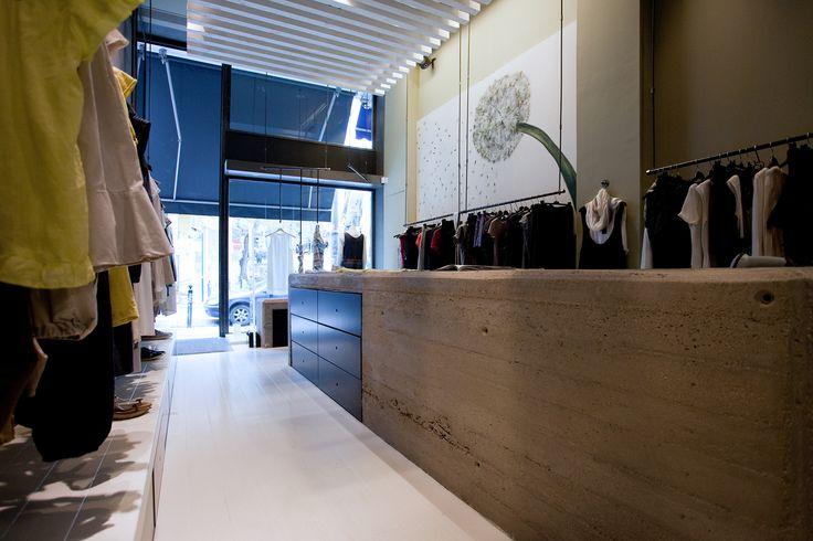 #badila #shop #interior #concrete #bench #artwork #painting