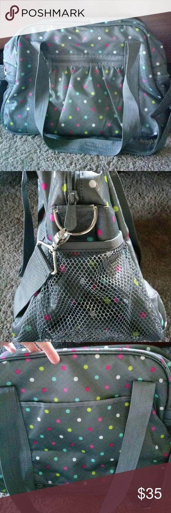 Weekender/Exercise Bag Fun Travel bag! Amazing Like New condition!! Exterior features 2 side mesh pockets, one from zipper pocket and another zipper pocket to fit right over your rolling suitcase handle! Interior features a large pocket, 2 flat pockets along with a place to put your earrings! Take this on your next adventure by Thirty-One!! Thirty-One Bags Travel Bags