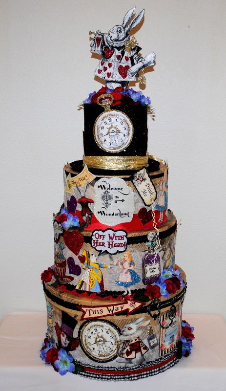 """An incredibly enchanting and fantasy filled """"Alice in Wonderland"""" Wedding Card/Reception Box. A whimsical creation covered in detailed vignettes from the top hat on down to the White Rabbit watching time from an assorted array of crazy clocks. Red and purple flowers, The Queen of Hearts, The Mad Hatter and Cheshire Cat all detailed with glitter that shines and sparkles! #Weddingcardboxes #Whimsicalcardboxes #largeweddingcardboxes"""