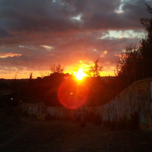 Last #night's #gorgeous #sunset  #beautiful #sunshine #sun #nature #naturelovers #nature_seekers #bestofinstagram #bestoftheday #sky #sunsetsofinstagram #natural #amazing #colors #trees #mountains #pink #red #blue #yellow #nofilter #graffiti #wall