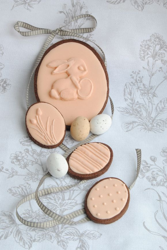 Easter cookies - soooo...what if icing were done with candy melts and a small molded candy of the same color was put on top? Could be cute.
