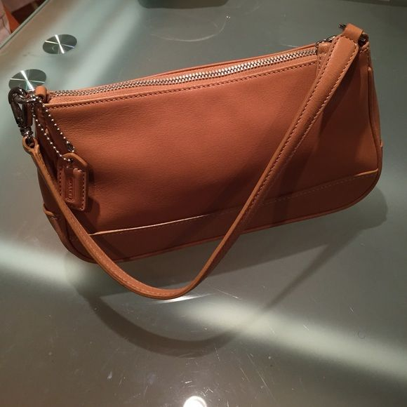 FINAL PRICE ‼️Authentic Coach camel shoulder bag  Authentic Coach camel leather small shoulder bag. It is in overall great condition. Only minor flaws I could spot were on the bottom as depicted in the third picture. ⛔️ NO TRADES ⛔️ PRICE IS FIRM ⛔️ Bundle for additional discounts! Coach Bags Shoulder Bags
