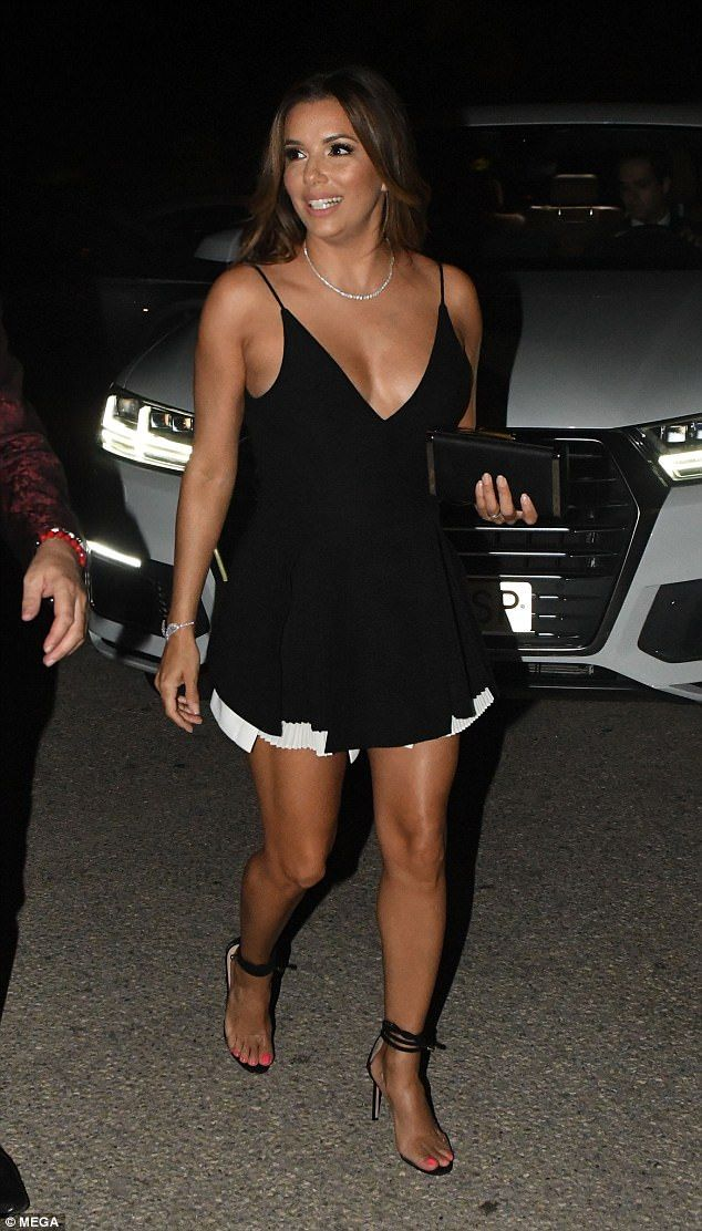 Looking good:Eva Longoria looked suitably glowing as she attended a charity dinner in the...