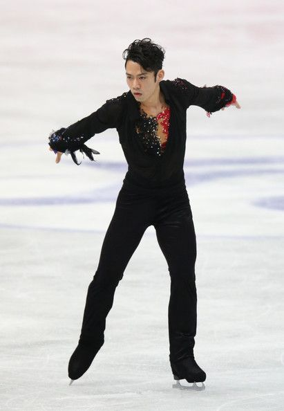 Daisuke Takahashi Photos Photos - Daisuke Takahashi of Japan competes in the Men's Free Skating during day two of the ISU Four Continents Figure Skating Championships at Osaka Municipal Central Gymnasium on February 9, 2013 in Osaka, Japan. - ISU Four Continents Figure Skating Championships - Day 2