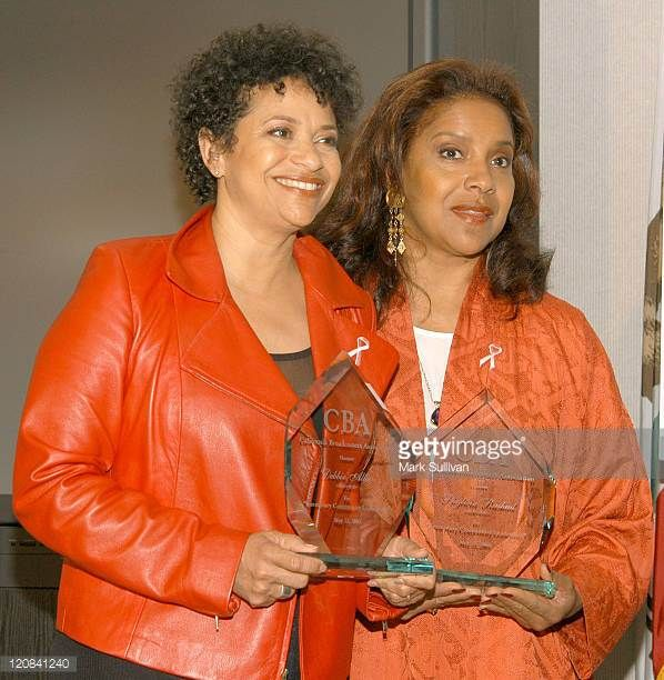 Debbie Allen and Phylicia Rashad with awards for service