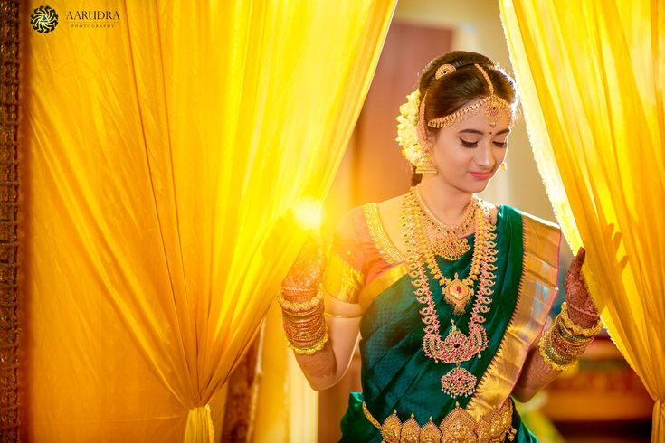South Indian bride. Gold Indian bridal jewelry.Temple jewelry. Jhumkis. Green silk kanchipuram sari.Braid with fresh jasmine flowers. Tamil bride. Telugu bride. Kannada bride. Hindu bride. Malayalee bride.Kerala bride.South Indian wedding.