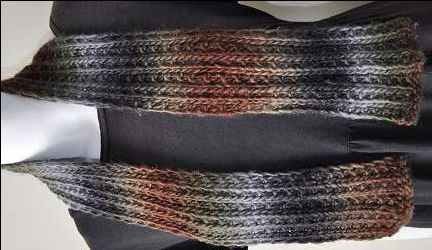 These four crochet scarf patterns feature one-of-a-kind cabled designs!