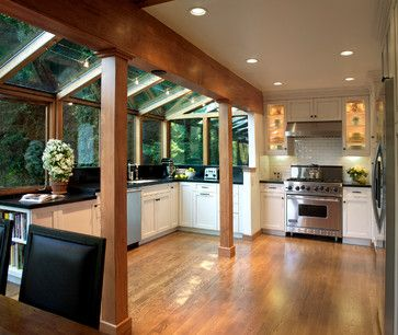 """Galley kitchen was cramped and lacked sunlight. The wall separating the kitchen from the sun room was removed and both issues were resolved. Douglas fir was used for the support beam and columns."""
