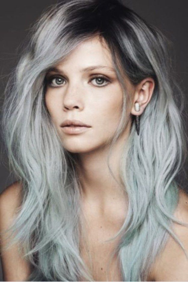 Black roots on gray or icy blue hair can add a dramatic touch (and also ease the transition between dyes once your roots start growing out).